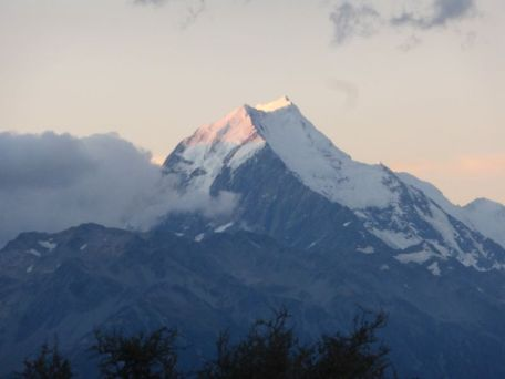Cook Alpenglow – A bit of alpenglow on Mt. Cook as viewed from our campground in Glentanner.