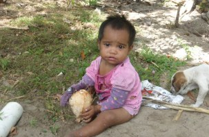 Mary - with a coconut to drink at Albert Cove, daughter of Pauline & John