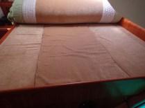 Roll back the upper mattress