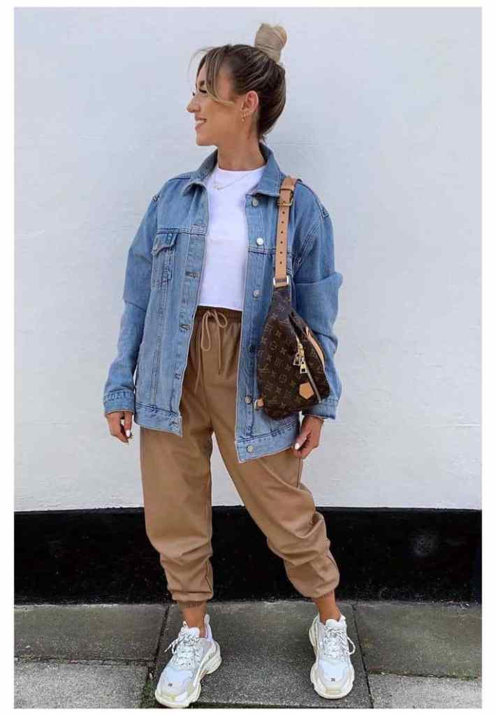 lady wearing jean jacket with white sneakers