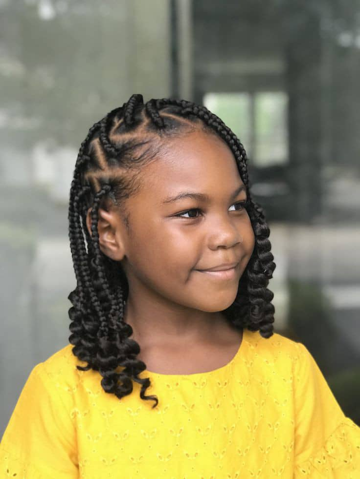 little girl wearing box braids