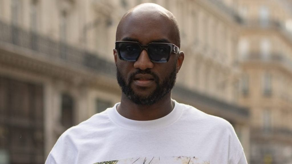 man wearing sunglasses and white t-shirt