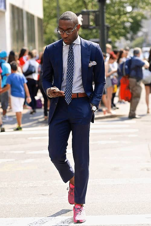 Rocking dark blue suit with red sneakers