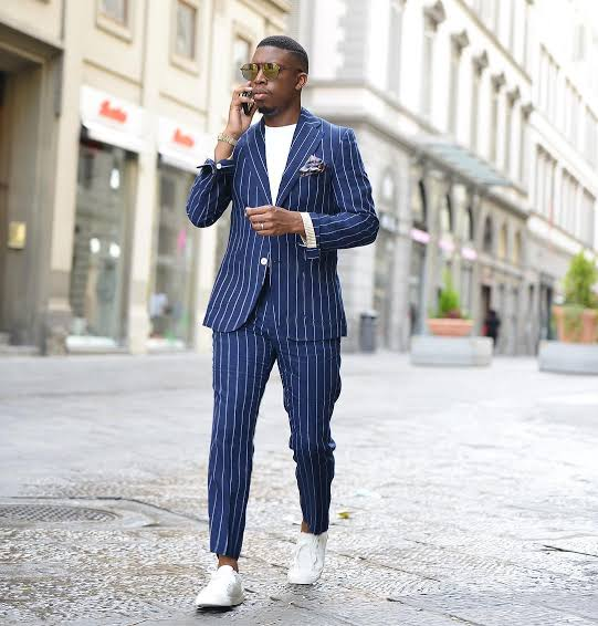 Dark blue striped suit with white sneakers - how to wear sneakers with suits
