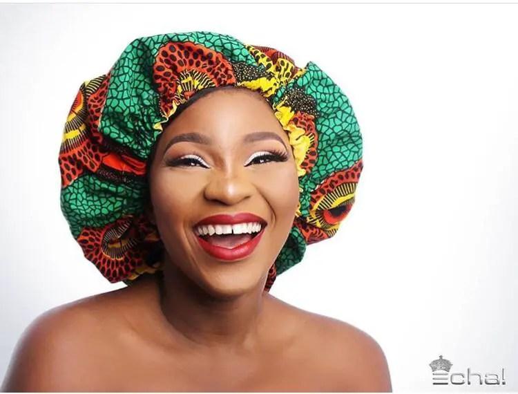 woman wearing ankara bonnet and smiling