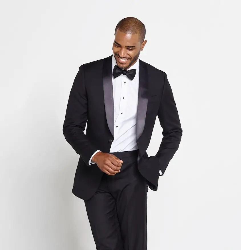 black shawl lapel tuxedo on a smiling African man