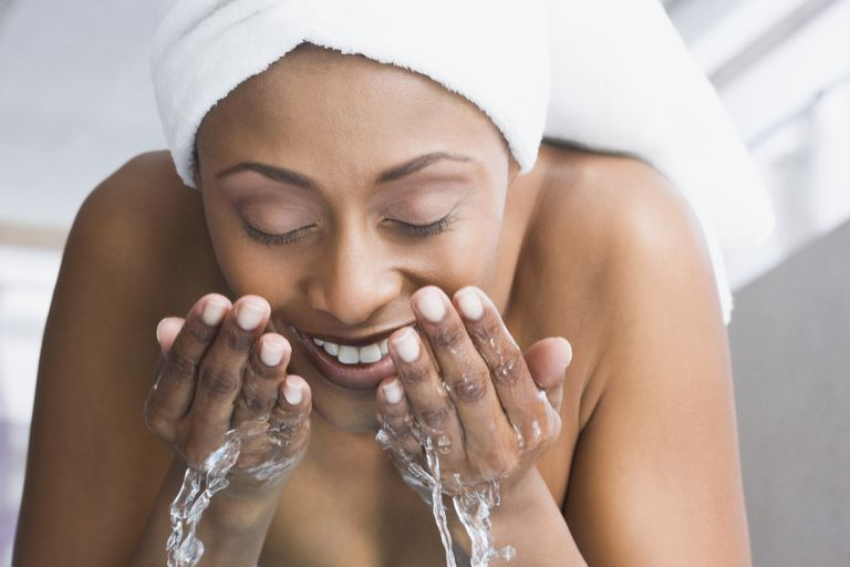 Woman washing her face - How to Treat an Oily Nose