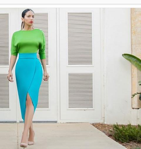 green top on blue midi skirt
