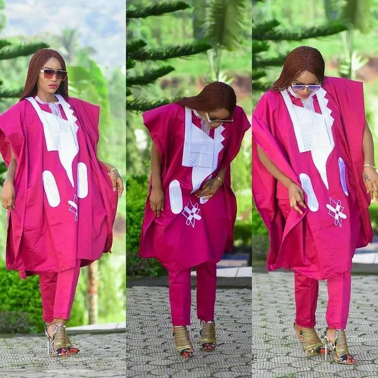 lady wearing reddish-purple agbada