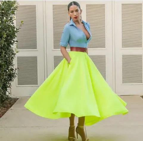 light-blue top on yellow flair midi skirt