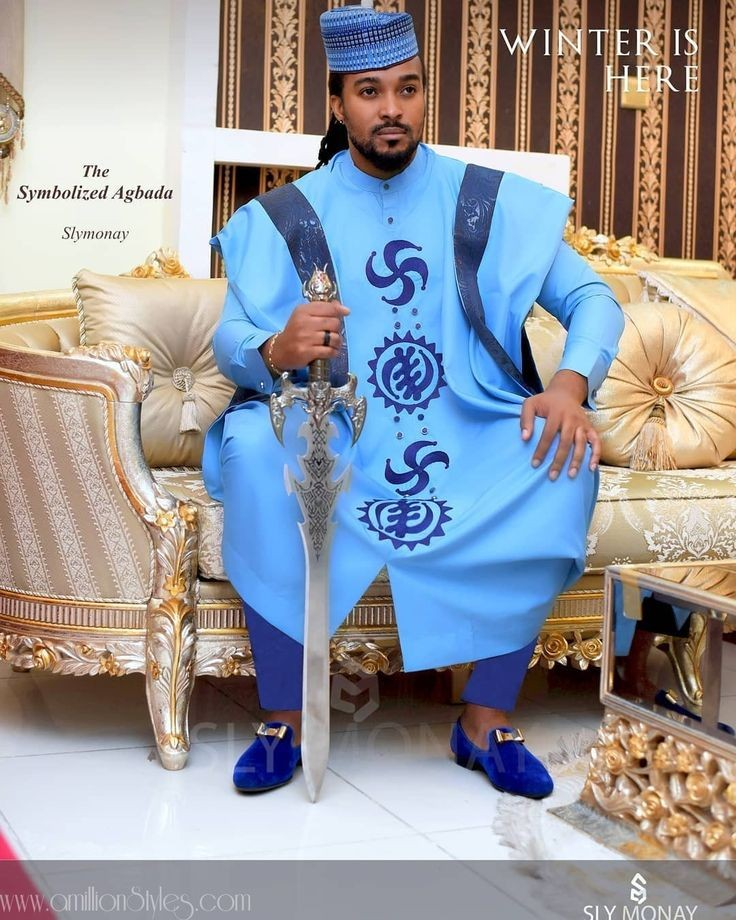 man wearing blue-shaded agbada ensemble