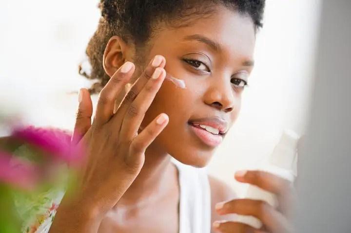 Black woman treating sunburn - How to Treat Sunburn