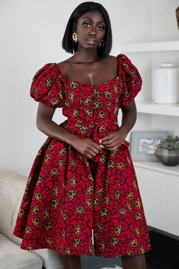 African woman with hairstyle for round-neck dress