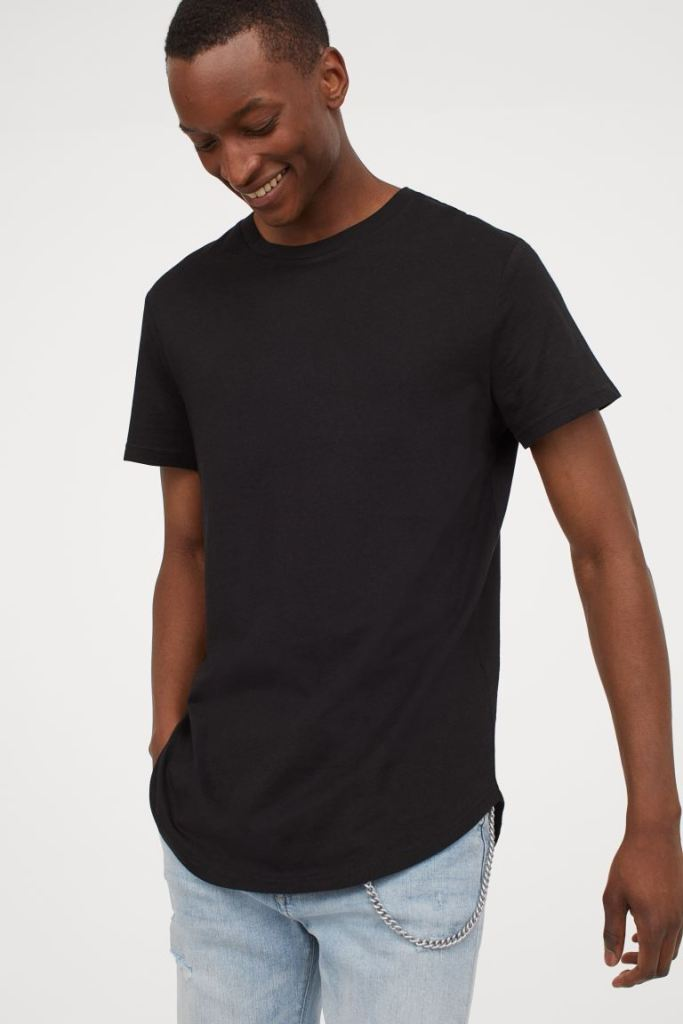 man on black t-shirt and light blue jeans