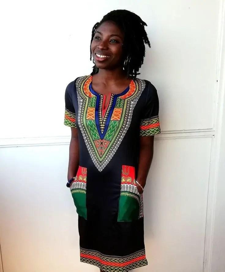 lady in a black shift dress