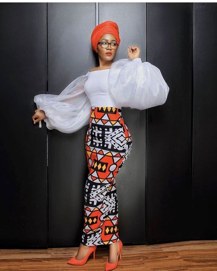 a lady in a native ankara outfit - Types of Outfits for Different Occasions