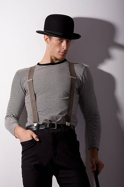man in hat and suspenders