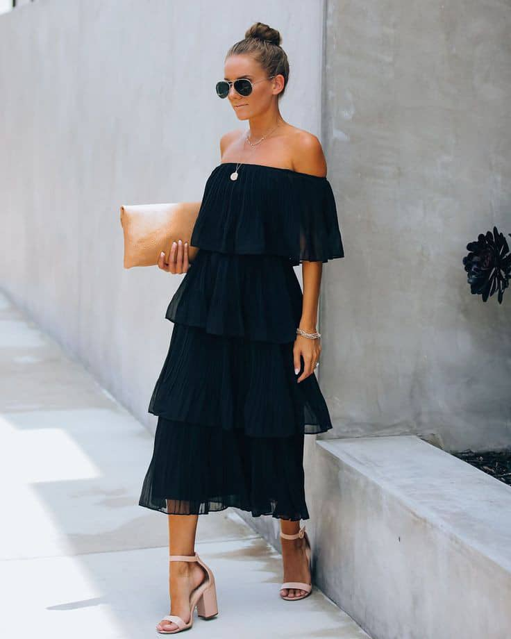 lady in an a black off-shoulder dress with a necklace