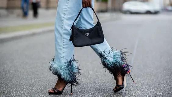 lady wearing jeans and walking in heels