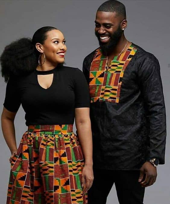 Man and woman in mixed kente and black outfit