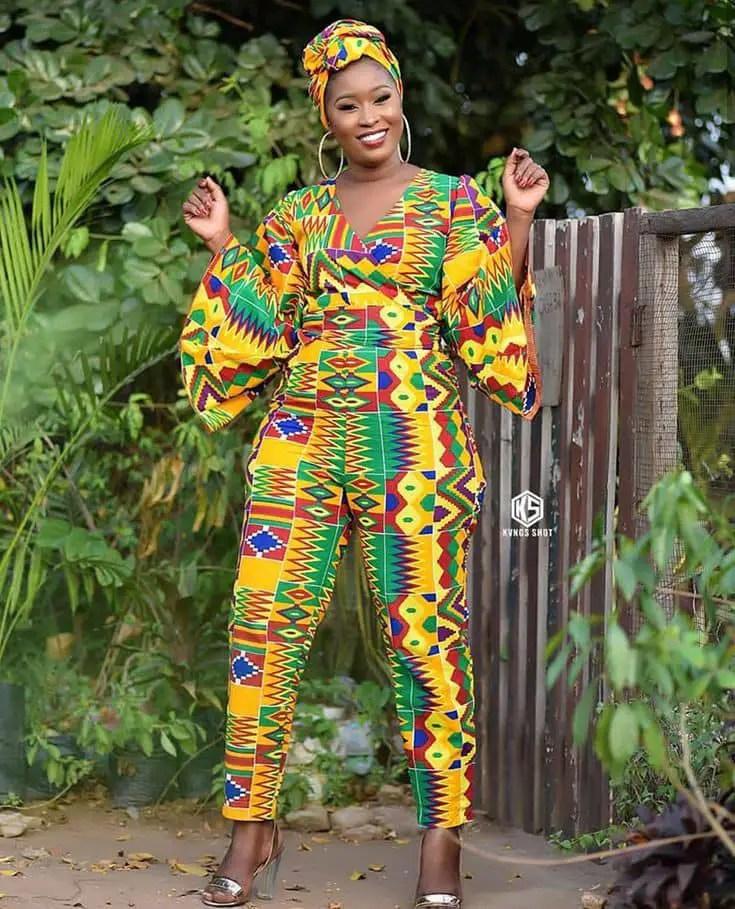 Beautiful lady rocking kente jumpsuit and smiling