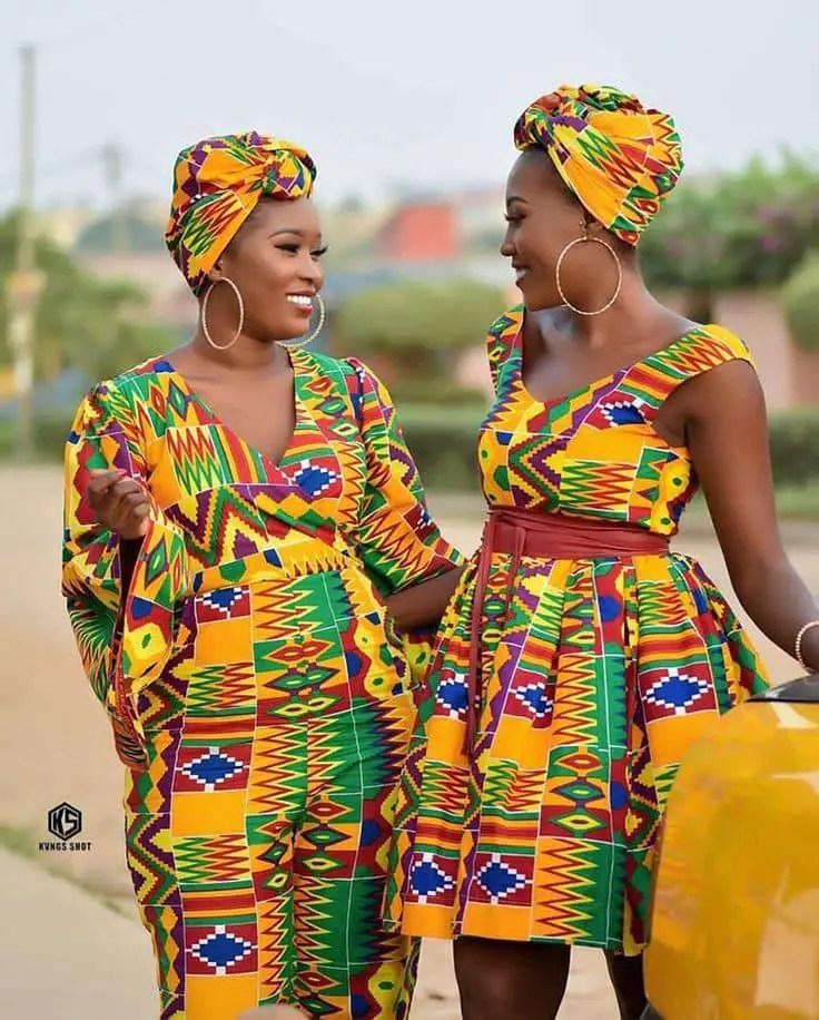 2 beautiful ladies wearing kente dresses