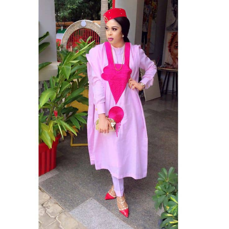 lady rocking white and pink agbada and cap
