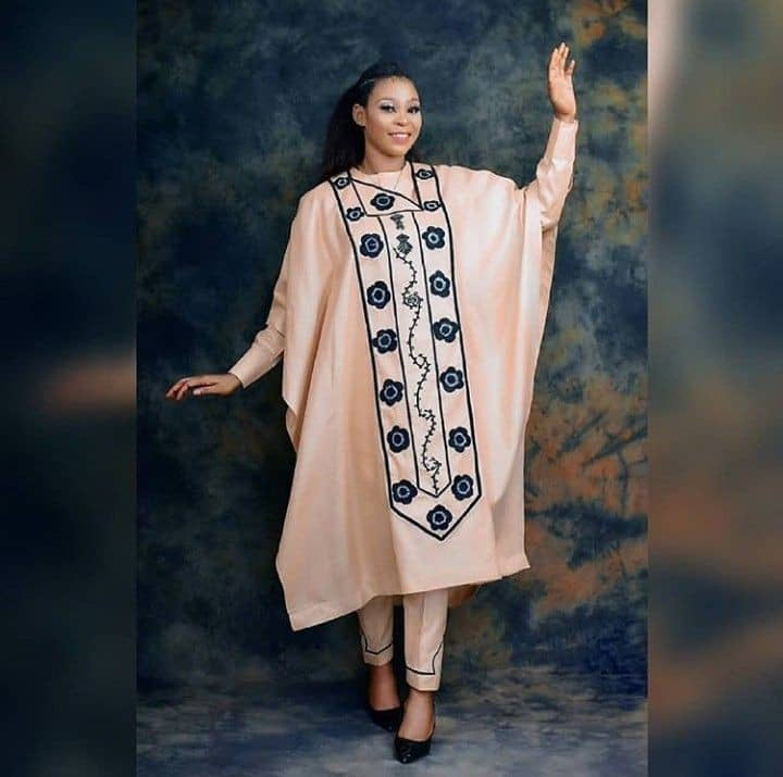 lady in an off-white embroidered agbada
