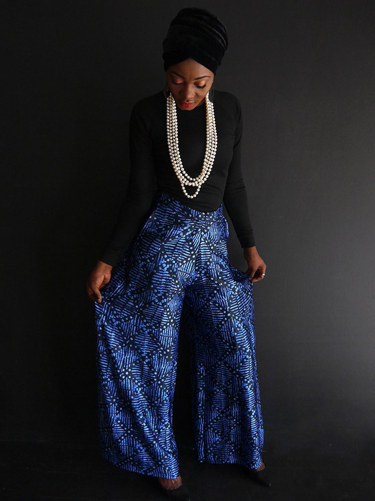 woman wearing adire trousers on black top