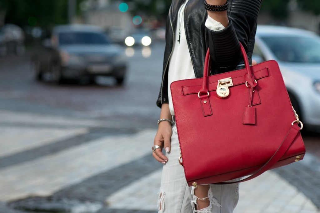 woman carrying a red satchel bag