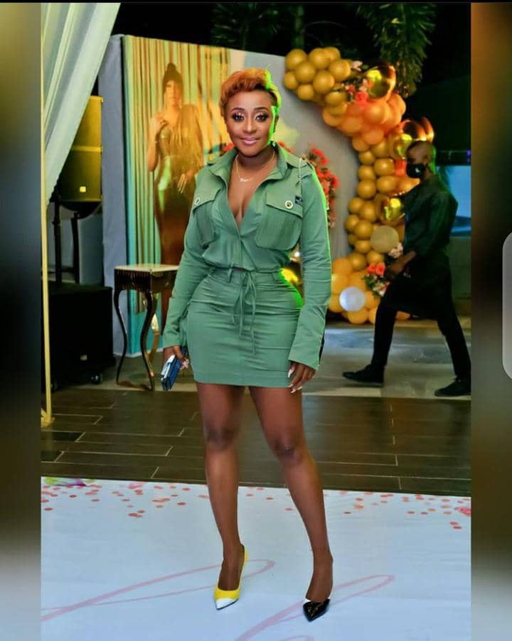 Ini Edo wearing mismatched shoes