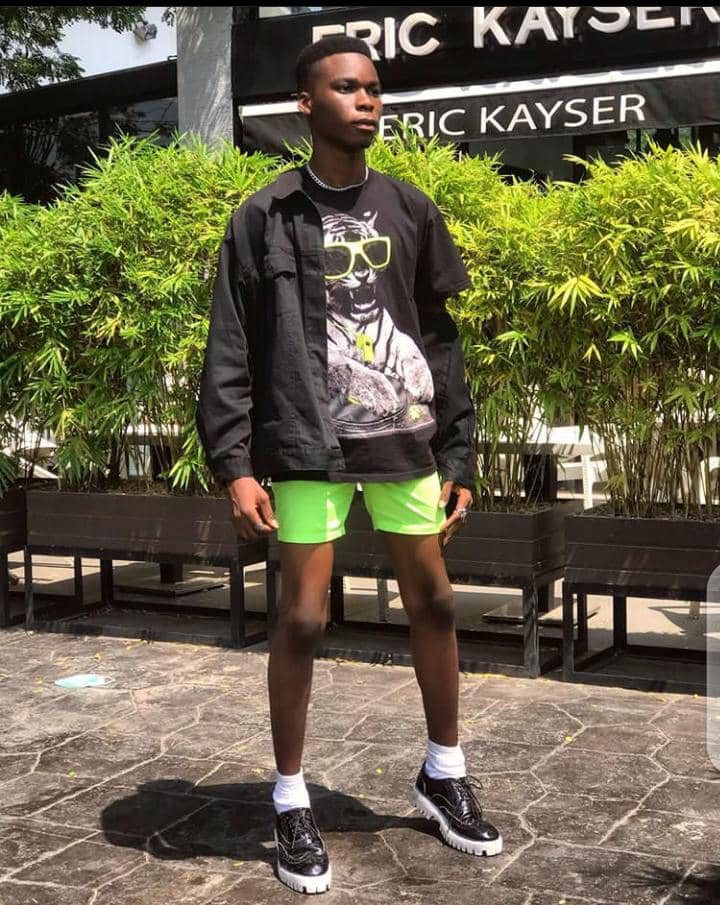man in black sneakers and shorts