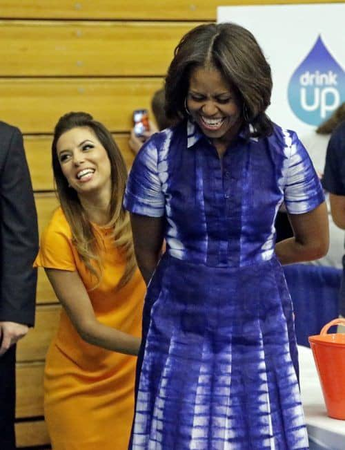 Michelle Obama wearing adire dress and laughing