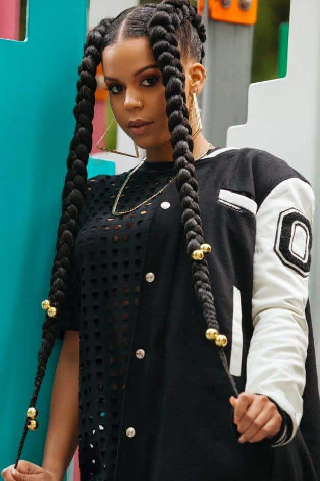 lady with big braids styled with beads