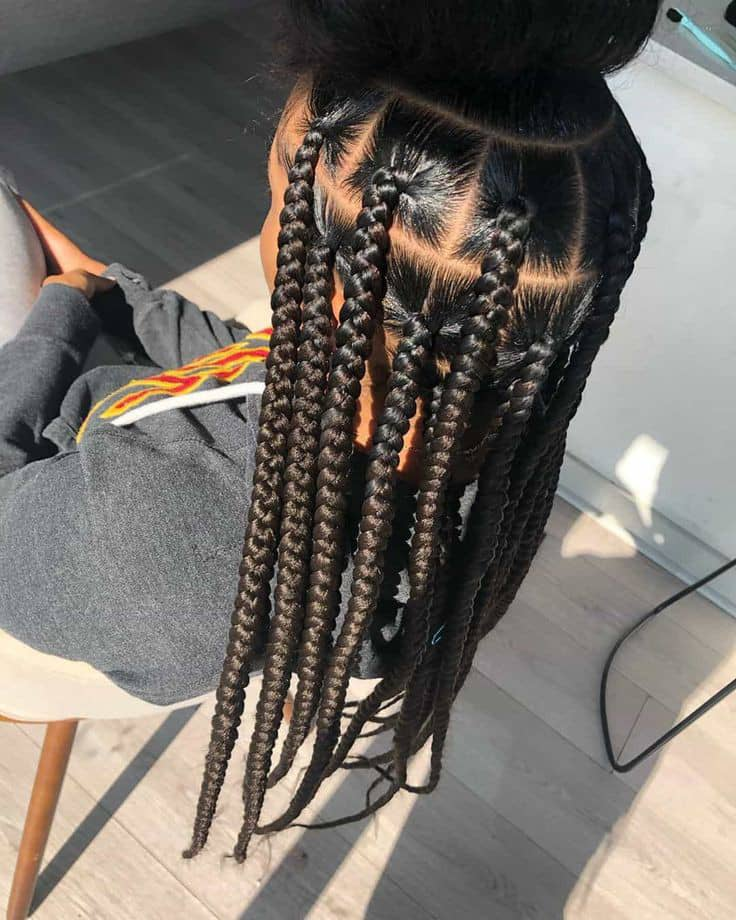 lady making box braids