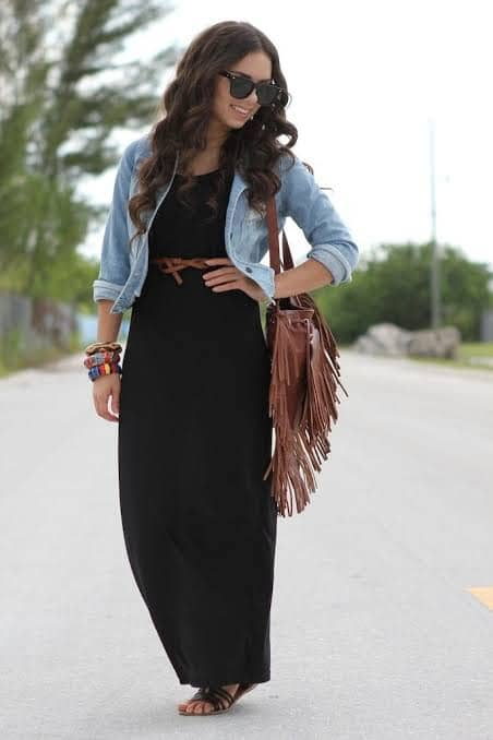 ladyy wearing a denim over a maxi dress