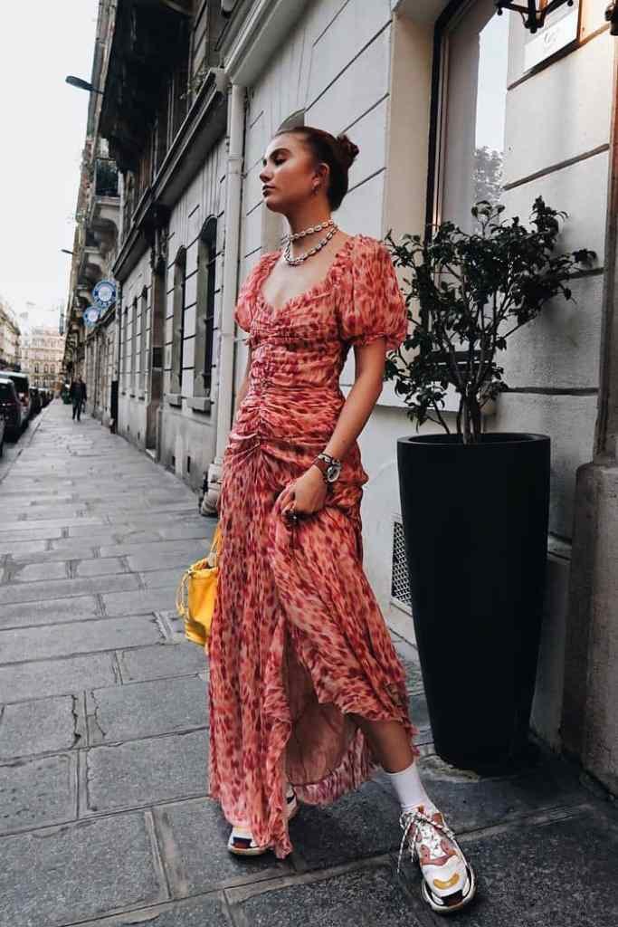 lady in a maxi dress with sneakers