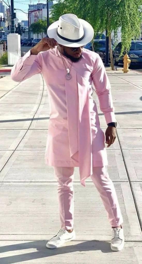 man wearing pink senator