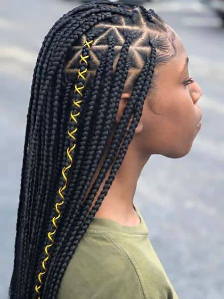 lady wearing tiny box braids