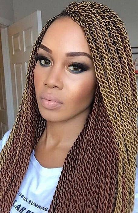 pretty lady rocking tiny Senegalese twists for Christmas