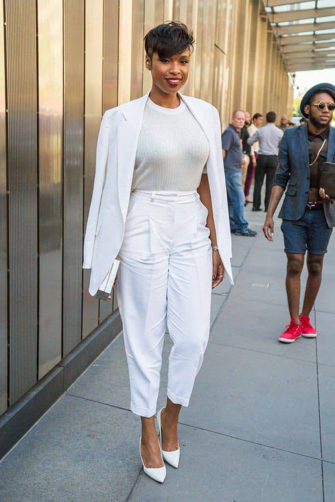 lady wearing white jacket on white top and white pants