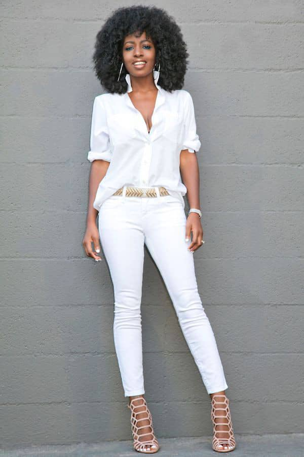 beautiful lady in a white shirt and jeans