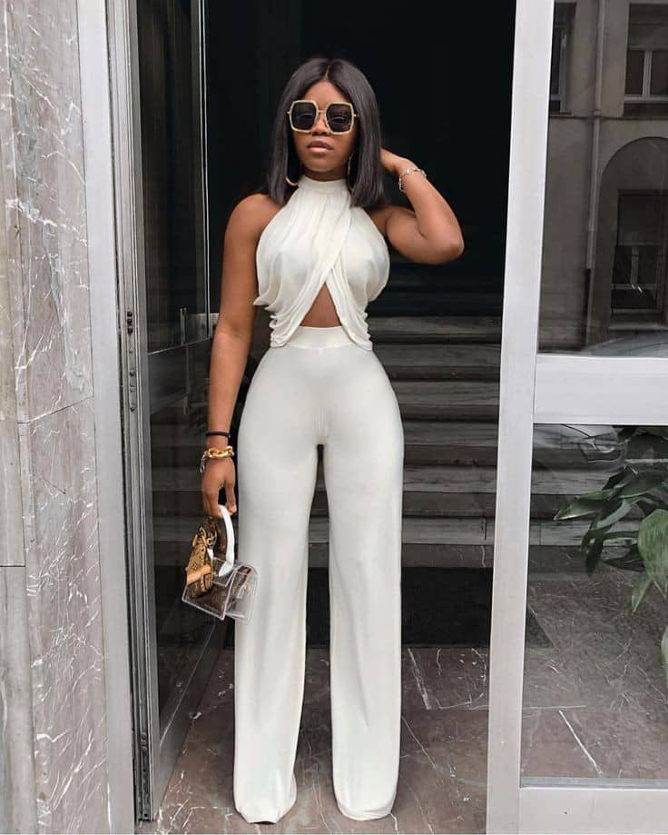 lady rocking white wrap top and pants