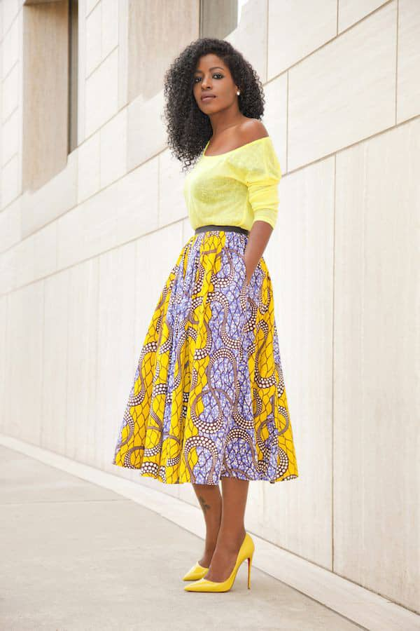 lady wearing a yellow ankara flare skirt