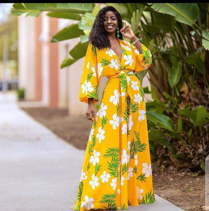 pretty lady in a yellow floral maxi dress