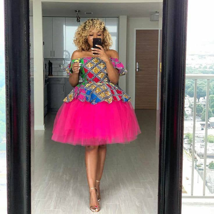 lady wearing ankara and tulle net short gown