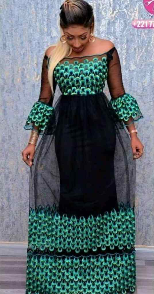 lady in long ankara gown with net