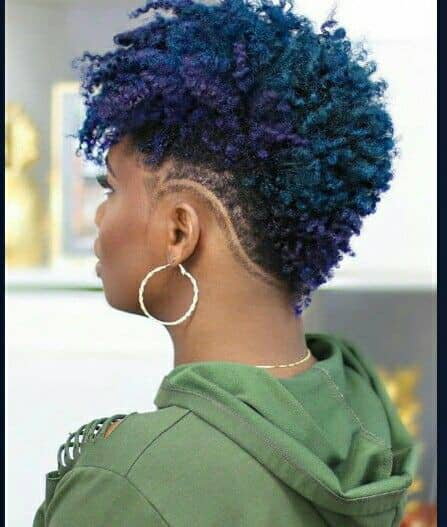 lady mixing blue and purple dye in her hair