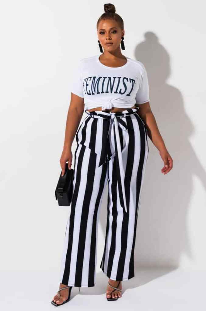 lady wearing T-shirt with black and white stripped palazzo pants