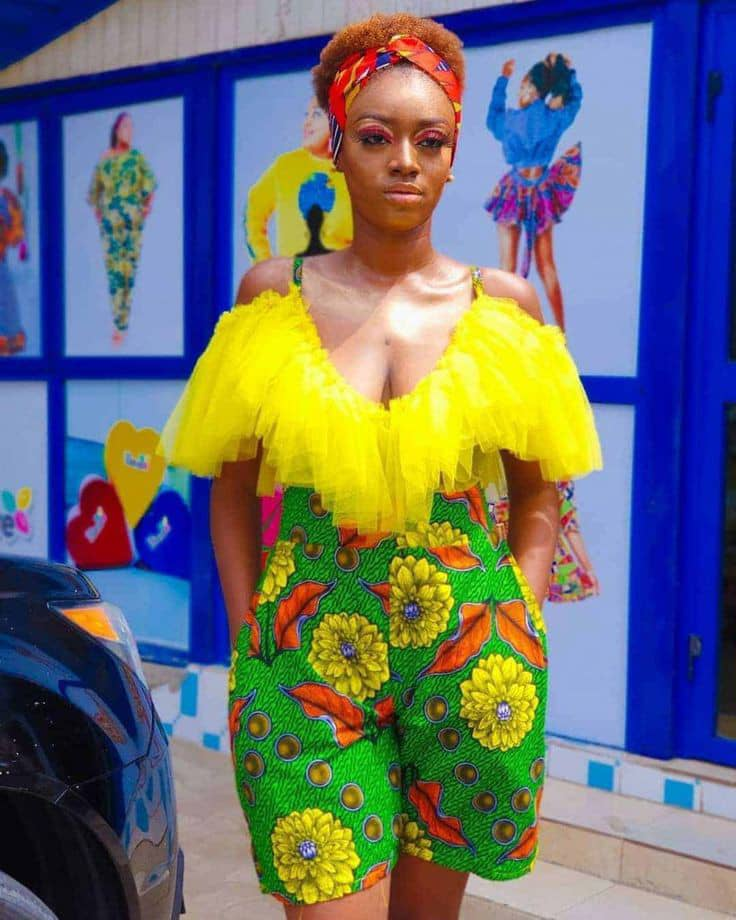 lady wearing playsuit made with ankara and net material